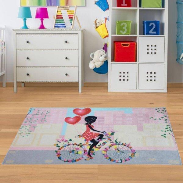 Kinderteppich Mädchen mit Fahrrad - Waschbar & Rutschfest